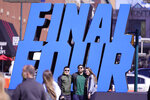 Fans pose with a Final Four logo before a college basketball game during the Final Four round of the NCAA tournament at Lucas Oil Stadium in Indianapolis, Saturday, April 3, 2021. (AP Photo/AJ Mast)