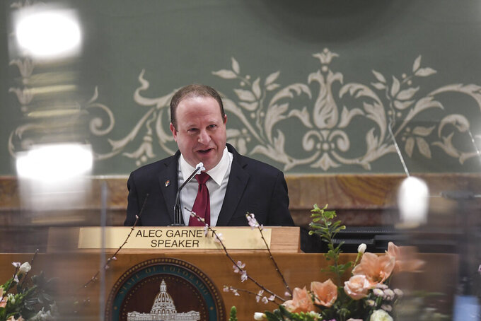 Gov. Jared Polis delivers his state of the state address in front of the House of Representatives at the Colorado State Capitol Building in Denver on Wednesday, Feb. 17, 2021. (AAron Ontiveroz/The Denver Post via AP, Pool)
