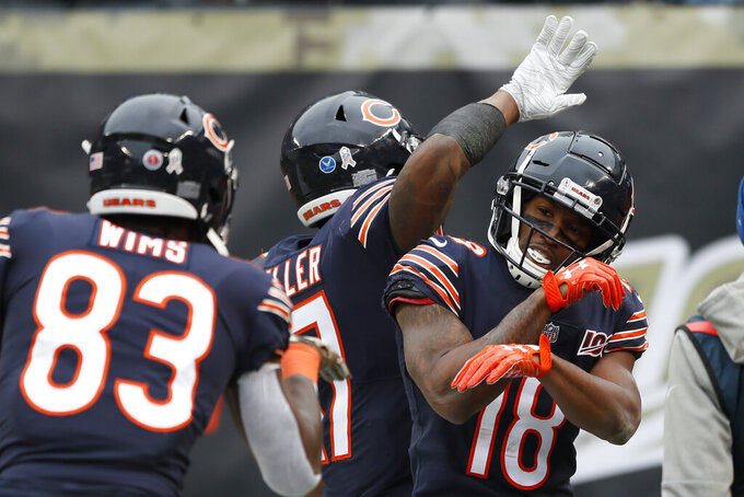 Chicago Bears wide receiver Taylor Gabriel (18) celebrates his 24-yard touchdown reception against the Detroit Lions during the second half of an NFL football game in Chicago, Sunday, Nov. 10, 2019. (AP Photo/Charlie Neibergall)