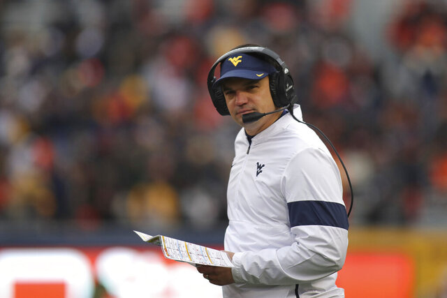 FILE - In this Nov. 23, 2019, file photo, West Virginia head coach Neal Brown watches during the second quarter of an NCAA college football game against Oklahoma State, in Morgantown, W.Va. .Brown went 5-7 in his first season at West Virginia in 2019 and faces challenges on both sides of the ball as the Mountaineers try to compete for a Big 12 title. (AP Photo/Chris Jackson, File)