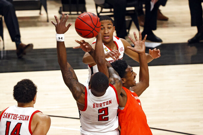 Texas Tech's Jamarius Burton (2) and Sam Houston State's Terryonte Thomas (5) vie for a rebound during the first half of an NCAA college basketball game Friday, Nov. 27, 2020, in Lubbock, Texas. (AP Photo/Brad Tollefson)