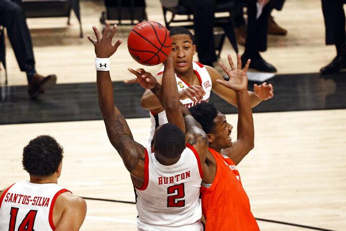 Texas Tech's Jamarius Burton (2) and Sam Houston State's Terryonte Thomas (5) vie for a rebound during the first half of an NCAA college basketball game Friday, Nov. 27, 2020, in Lubbock, Texas. (AP Photo/Brad Tollefson)