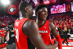 FILE - In this Feb. 19, 2020, file photo, Georgia guard Anthony Edwards, right, and forward Mike Peake celebrate after an NCAA college basketball game against Auburn in Athens, Ga. Edwards was selected to the Associated Press All-SEC first team announced Tuesday, March 10, 2020. Edwards was also named the AP SEC Newcomer of the Year. (AP Photo/John Amis, File )