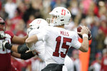 Stanford quarterback Davis Mills (15) throws a pass during the first half of an NCAA college football game against Washington State in Pullman, Wash., Saturday, Nov. 16, 2019. (AP Photo/Young Kwak)