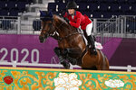 United States' Jessica Springsteen, riding Don Juan van de Donkhoeve, competes during the equestrian jumping individual qualifying at Equestrian Park in Tokyo at the 2020 Summer Olympics, Tuesday, Aug. 3, 2021, in Tokyo, Japan. (AP Photo/Carolyn Kaster)