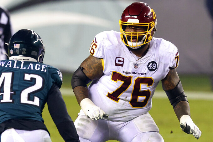 FILE - In this Jan. 3, 2021, file photo, Washington Football Team's Morgan Moses (76) blocks against the Philadelphia Eagles during an NFL football game against the Philadelphia Eagles in Philadelphia. A person with direct knowledge of the move said Washington is releasing longtime starting right tackle Morgan Moses and reserve Geron Christian. The person spoke to The Associated Press on condition of anonymity Thursday, May 20, 2021, because the team had not announced the transactions. They're expected to be made official soon. (AP Photo/Rich Schultz, File)