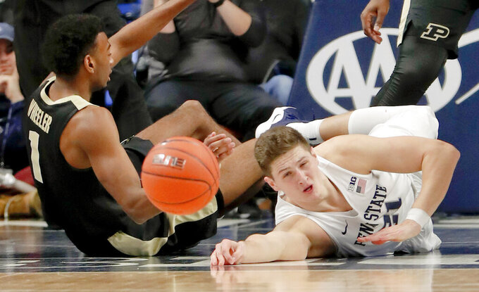 Penn State's John Harrar, right, and Purdue's Aaron Wheeler (1) scramble for a loose ball during the first half of an NCAA college basketball game Thursday, Jan. 31, 2019, in State College, Pa. (AP Photo/Keith Srakocic)