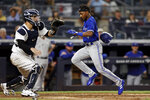 Toronto Blue Jays' Jarrod Dyson scores a run past New York Yankees catcher Gary Sanchez during the eighth inning of a baseball game Wednesday, Sept. 8, 2021, in New York. (AP Photo/Adam Hunger)