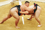 FILE - In this July 19, 2005, file photo, Sumo wrestler Takayuki Ichihara from Japan, left, fights against compatriot Keisho Shimoda in the heavyweight final of the Sumo tournament at the World Games in Duisburg, Germany. Joining the array of postponed events in the midst of the coronavirus pandemic, officials announced Thursday that the 11th edition of the World Games in Birmingham, Alabama will now be held in the summer of 2022. (AP Photo/Martin Meissner, FIle)