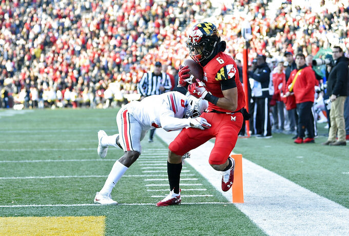 Maryland wide receiver Jeshaun Jones (6) scores a touchdown against Ohio State cornerback Kendall Sheffield (8) during the second half of an NCAA college football game, Saturday, Nov. 17, 2018, in College Park, Md. Ohio State won 52-51 in overtime. (AP Photo/Nick Wass)