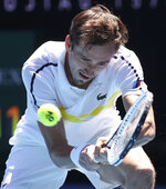 Russia's Daniil Medvedev hits a backhand to United States' Mackenzie McDonald during their fourth round match at the Australian Open tennis championships in Melbourne, Australia, Monday, Feb. 15, 2021. (AP Photo/Hamish Blair)