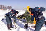 In this photo provided by the Russian Emergency Situations Ministry, an emergency team works at the scene of a AN-148 plane crash in Stepanovskoye village, about 40 kilometers (25 miles) from the Domodedovo airport, Russia, Tuesday, Feb. 13, 2018. Investigators are studying the information from flight recorders of a Russian passenger plane that has crashed near Moscow killing all 71 people on board. The Moscow-based Interstate Aviation Committee said Tuesday its experts managed to recover the data from both the plane's flight data and cockpit conversation recorders.  (Russian Ministry for Emergency Situations photo via AP)