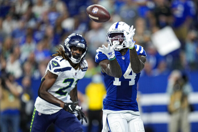 Indianapolis Colts wide receiver Zach Pascal (14) makes catch for a touchdown in front of Seattle Seahawks cornerback Tre Flowers (21) during the second half of an NFL football game in Indianapolis, Sunday, Sept. 12, 2021. (AP Photo/AJ Mast)