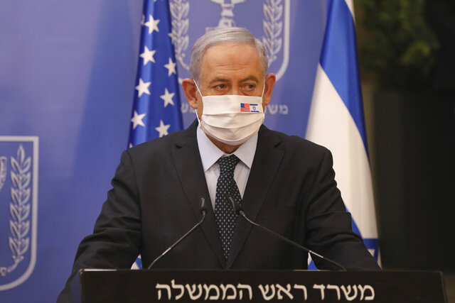 Israeli Prime Minister Benjamin Netanyahu wears a face mask during a media statement with US special envoy for Iran, Brian Hook, at the Prime Minister's office in Jerusalem, Tuesday June 30, 2020. (Abir Sultan/Pool via AP)