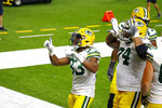 Green Bay Packers running back Aaron Jones (33) celebrates his touchdown with offensive guard Elgton Jenkins (74) in the second half of an NFL football game against the New Orleans Saints in New Orleans, Sunday, Sept. 27, 2020. (AP Photo/Butch Dill)