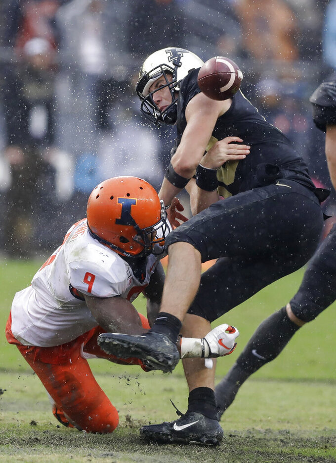 Purdue quarterback Jack Plummer (13) fumbles after getting hit by Illinois linebacker Dele Harding (9) during the second half of an NCAA college football game, Saturday, Oct. 26, 2019, in West Lafayette, Ind. (AP Photo/Darron Cummings)