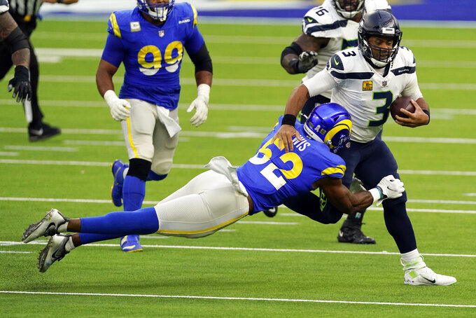 Seattle Seahawks quarterback Russell Wilson (3) is tackled by Los Angeles Rams linebacker Terrell Lewis (52) during the second half of an NFL football game Sunday, Nov. 15, 2020, in Inglewood, Calif. (AP Photo/Ashley Landis)