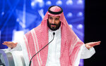 FILE - In this Oct. 24, 2018photo released by Saudi Press Agency, SPA, Saudi Crown Prince, Mohammed bin Salman addresses the Future Investment Initiative conference, in Riyadh, Saudi Arabia. Salman's first trip abroad since the killing of Khashoggi will offer an early indication of whether he will face any repercussions. The prince is visiting close allies in the Middle East before attending the Group of 20 Summit in Argentina, where he will come face to face with Trump, who appears keen to preserve their friendship, as well as European leaders and Turkey's president, who has stepped up pressure on the kingdom.  (Saudi Press Agency via AP, File)
