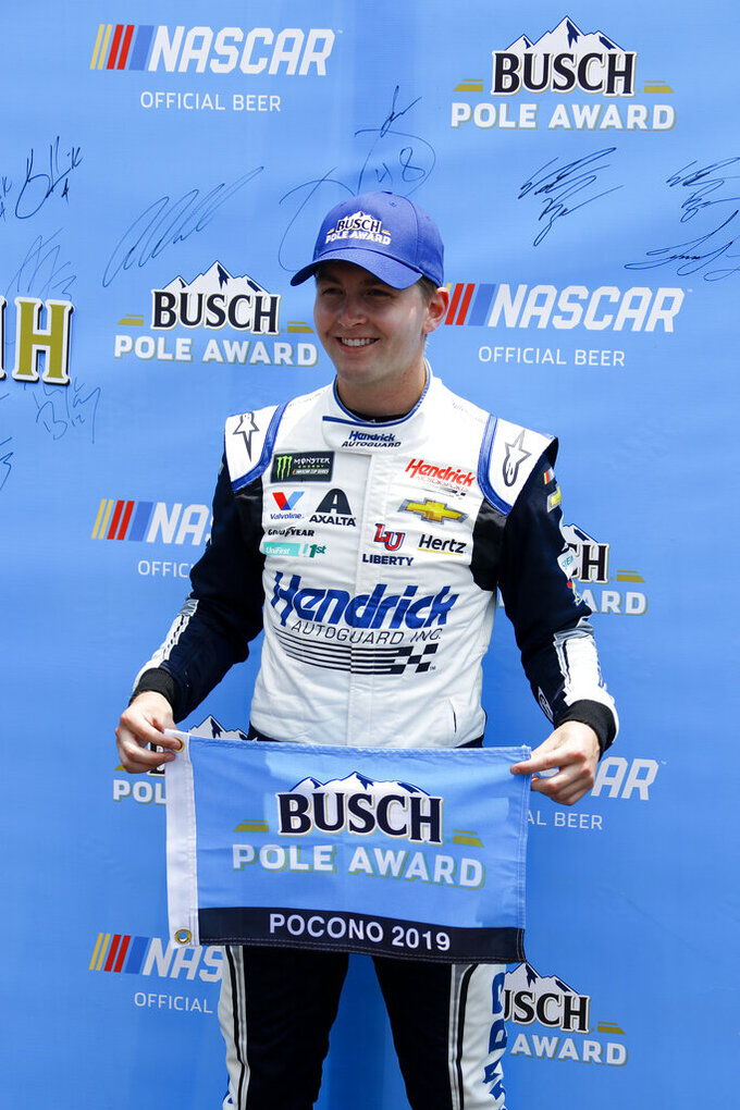 William Byron poses poses with the pole award after qualifying first for Sunday's NASCAR Cup Series auto race at Pocono Raceway, Saturday, June 1, 2019, in Long Pond, Pa. (AP Photo/Matt Slocum)