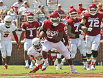 Oklahoma wide receiver Lee Morris (84) avoids a tackle by Florida Atlantic cornerback Korel Smith (29) and runs a Kyler Murray pass in for a touchdown in the first half of an NCAA college football game in Norman, Okla., Saturday, Sept. 1, 2018. (AP Photo/Sue Ogrocki)