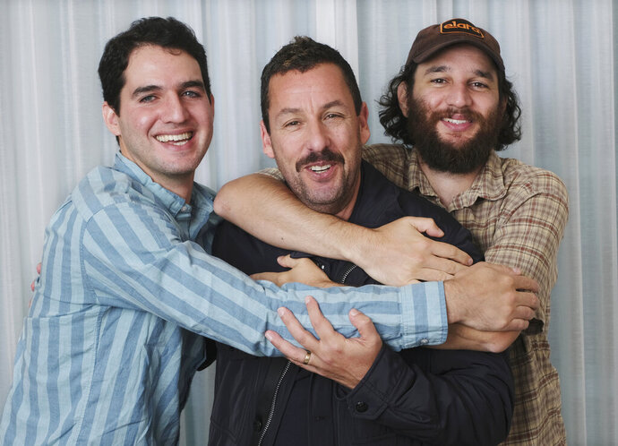 This Sept. 9, 2019 photo shows Adam Sandler, center, star of the film