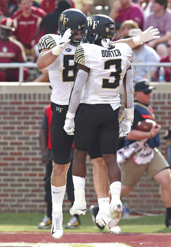 Wake Forest's Jack Freudenthal celebrates scoring a touchdown with teammate Greg Dortch in the first quarter of an NCAA college football game with Florida State, Saturday, Oct. 20, 2018 in Tallahassee, Fla. (AP Photo/Steve Cannon)