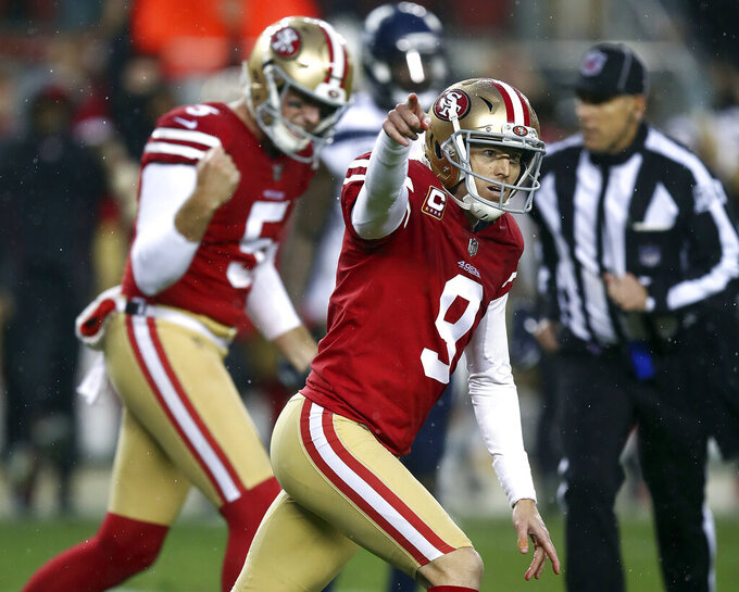 FILE - In this Dec. 16, 2018, file photo, San Francisco 49ers kicker Robbie Gould (9) celebrates after kicking a field goal during overtime of an NFL football game to beat the Seattle Seahawks in Santa Clara, Calif. Five defensive players, all premier pass rushers, and 49ers placekicker Robbie Gould, were given franchise tags by their teams before the NFL deadline on Tuesday, March 5, 2019. (AP Photo/Ben Margot, File)