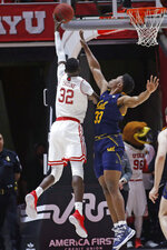 Utah center Lahat Thioune (32) lays the ball up as California forward D.J. Thorpe (33) defends during the first half of an NCAA college basketball game Saturday, Feb. 8, 2020, in Salt Lake City. (AP Photo/Rick Bowmer)