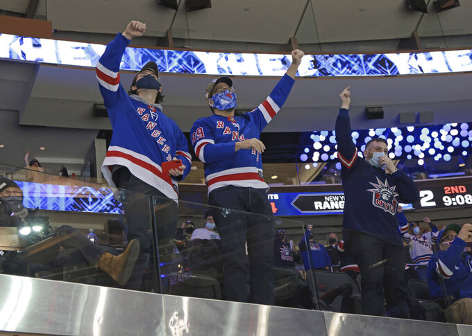 New York Rangers fans celebrate a second-period goal against the Philadelphia Flyers during an NHL hockey game at Madison Square Garden, Monday, March 15, 2021, in New York. (Bruce Bennett/Pool Photo via AP)