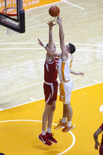 Tennessee's John Fulkerson (10) shoots against Arkansas forward Connor Vanover (23) during an NCAA college basketball game Saturday, Jan. 2, 2021, in Knoxville, Tenn. (Randy Sartin/USA TODAY Sports via AP, Pool)