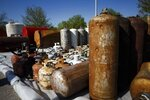 In this Wednesday, April 24, 2019 photo, orphaned containers sit quarantined in a rest stop on Interstate 29 north of Pacific Junction, Iowa. The Environmental Protection Agency has been trying to find, organize, return or dispose of containers holding hazardous materials that were carried away by the flood waters. (Brian Powers/The Des Moines Register via AP)