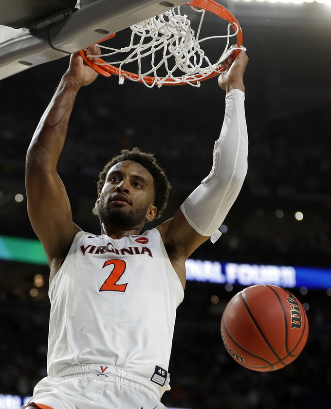 Virginia's Braxton Key (2) dunks during the overtime in the championship of the Final Four NCAA college basketball tournament against Texas Tech, Monday, April 8, 2019, in Minneapolis. (AP Photo/David J. Phillip)