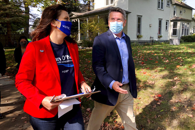 Michigan Gov. Gretchen Whitmer campaigns with Dan O'Neil, a Democratic candidate for the Michigan House in Traverse City, Mich., Friday, Oct. 9, 2020. Whitmer visited the area the day after police announced a foiled plot to kidnap the governor. (AP Photo/John Flesher)