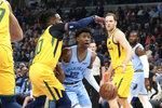 Memphis Grizzlies' Ja Morant (12) drives the ball past Utah Jazz's Mike Conley (10) during the first half of an NBA basketball game Friday, Nov. 15, 2019, in Memphis, Tenn. (AP Photo/Karen Pulfer Focht)
