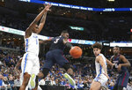 The ball gets away from South Carolina State's Rayshawn Neal (3) as Memphis' D. J. Jeffries (0) defends during the first half of an NCAA college basketball game Tuesday, Nov. 5, 2019, in Memphis, Tenn. (AP Photo/Karen Pulfer Focht)