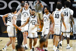 Vanderbilt players celebrate after defeating South Carolina in an NCAA college basketball game Saturday, Jan. 30, 2021, in Nashville, Tenn. (AP Photo/Mark Humphrey)