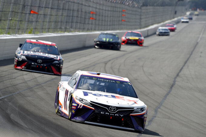 Denny Hamlin (11) drives through Turn 1 during a NASCAR Cup Series auto race, Sunday, July 28, 2019, in Long Pond, Pa. Hamlin won the race. (AP Photo/Derik Hamilton)