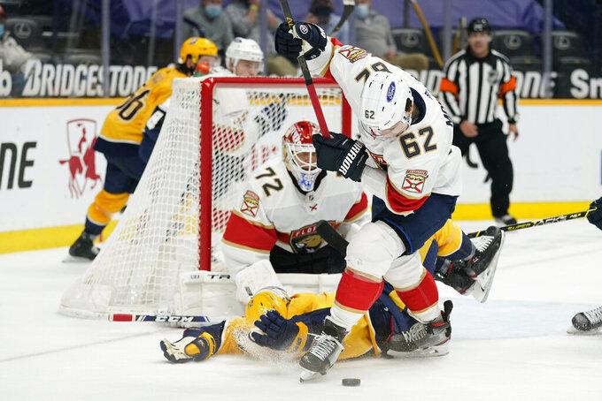 Florida Panthers defenseman Brandon Montour (62) collides with Nashville Predators center Nick Cousins, bottom, in the second period of an NHL hockey game Tuesday, April 27, 2021, in Nashville, Tenn. (AP Photo/Mark Humphrey)