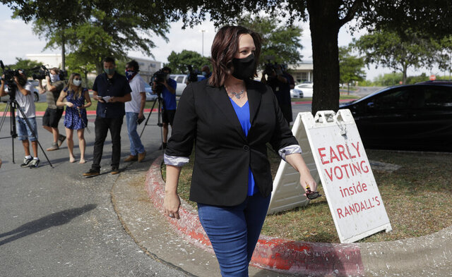 Democratic U.S. Senate candidate MJ Hegar heads to an early polling site after talking with the media, Thursday, July 9, 2020, in Austin, Texas. Hegar is in a runoff with State Sen. Royce West. (AP Photo/Eric Gay)
