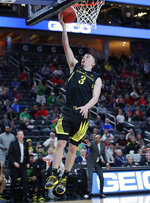 Oregon's Payton Pritchard shoots against Utah during the second half of an NCAA college basketball game in the quarterfinals of the Pac-12 men's tournament Thursday, March 14, 2019, in Las Vegas. (AP Photo/John Locher)