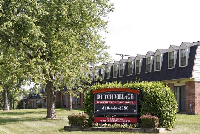 FILE - In this July 29, 2019, photo, a sign sits outside the Dutch Village apartments and townhomes, owned by the Kushner Cos., in Baltimore.  Maryland's attorney general is suing a real estate company once run by Jared Kushner, President Donald Trump's son-in-law for allegedly illegal and harmful rental practices, including rodent and vermin infestations. Attorney General Brian Frosh announced Wednesday, Oct. 23, that his office's Consumer Protection Division has filed charges against Westminster Management.  Kushner, a senior adviser to Trump, stepped down as CEO of the family business before joining the White House. But he still has an ownership stake in the subsidiary.   (AP Photo/Steve Ruark, File)