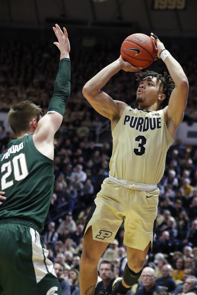 Purdue guard Carsen Edwards (3) shoots over Michigan State guard Matt McQuaid (20) during the second half of an NCAA college basketball game in West Lafayette, Ind., Sunday, Jan. 27, 2019. Purdue defeated Michigan State 73-63. (AP Photo/Michael Conroy)