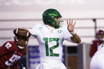 Oregon quarterback Tyler Shough (12) prepares to throw a pass during the first half of the team's NCAA college football game against Washington State in Pullman, Wash., Saturday, Nov. 14, 2020. (AP Photo/Young Kwak)