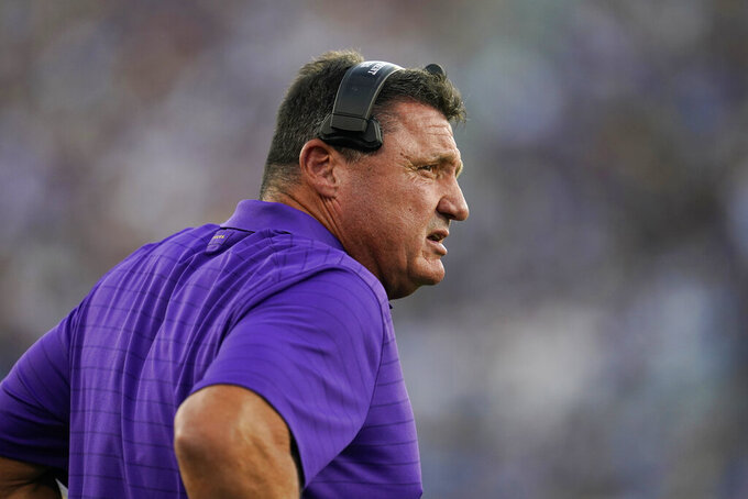 LSU coach Ed Orgeron watches from the sideline during the first half of the team's NCAA college football game against UCLA on Saturday, Sept. 4, 2021, in Pasadena, Calif. (AP Photo/Marcio Jose Sanchez)