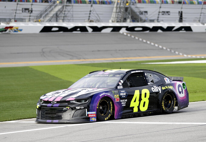 FILE - In this Feb. 15, 2019, file photo, Jimmie Johnson (48) drives down pit road on his way to the track during a practice session for the NASCAR Daytona 500 at Daytona International Speedway in Daytona Beach, Fla. The final three playoff spots are up for grabs as stock-car racing returns to the high-banked superspeedway two weeks after running the road course. Nearly half the field is looking to clinch a postseason berth with a victory, including seven-time series champion Jimmie Johnson. (AP Photo/John Raoux, File)