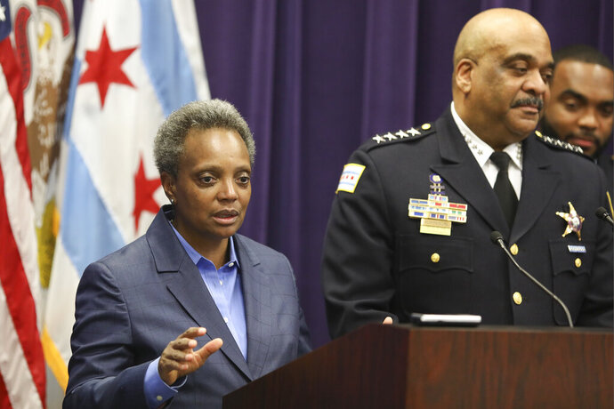 FILE - In this Nov. 7, 2019 file photo, Mayor Lori Lightfoot speaks as Chicago Police Superintendent Eddie Johnson announces his retirement after more than three years leading the department in Chicago. Mayor Lightfoot  fired Police Supt. Eddie Johnson Monday Dec. 2, 2019, due to his