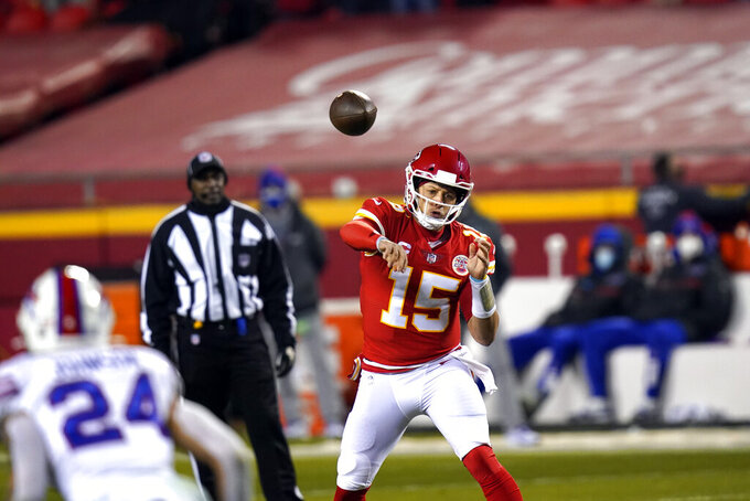 Kansas City Chiefs quarterback Patrick Mahomes throws a pass during the first half of the AFC championship NFL football game against the Buffalo Bills, Sunday, Jan. 24, 2021, in Kansas City, Mo. (AP Photo/Orlin Wagner)