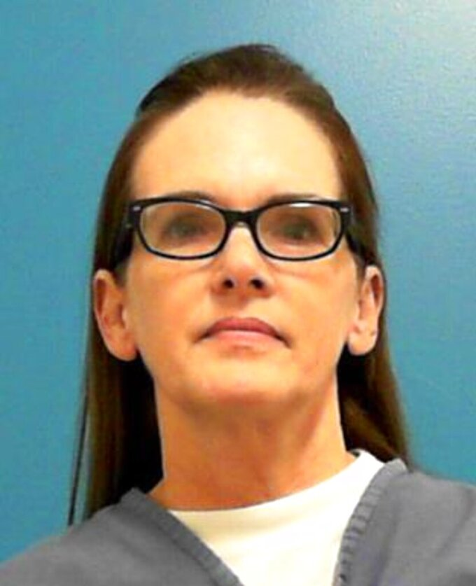 This undated image provided by the Florida Department of Corrections shows Denise Williams. Williams, a Florida woman convicted of helping mastermind the killing of her husband more than two decades ago was sentenced Thursday, Sept. 9, 2021 to 30 years in prison after a previous life sentence was tossed on appeal. (Florida Department of Corrections via AP)