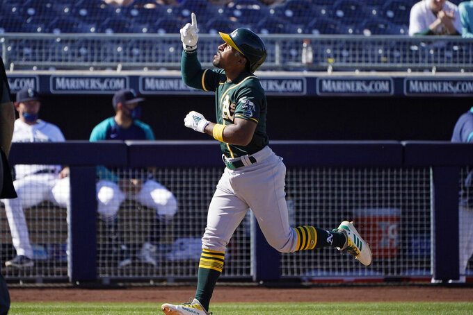 Oakland Athletics' Tony Kemp gestures as he runs toward home plate on a solo home run during the sixth inning of the team's spring training baseball game against the Seattle Mariners, Saturday, March 6, 2021, in Peoria, Ariz. (AP Photo/Sue Ogrocki)