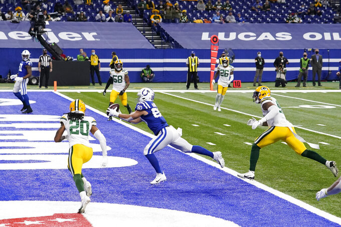 Indianapolis Colts tight end Trey Burton (80) makes a touchdown catch during the first half of an NFL football game against the Green Bay Packers, Sunday, Nov. 22, 2020, in Indianapolis. (AP Photo/Michael Conroy)